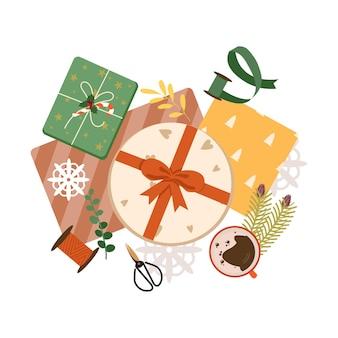 Vista superior del proceso de envoltura de regalos de navidad preparación para la celebración de navidad y año nuevo