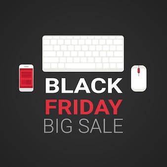 Vista superior del teclado de la computadora y el teléfono inteligente con mensaje de texto de gran venta del viernes negro