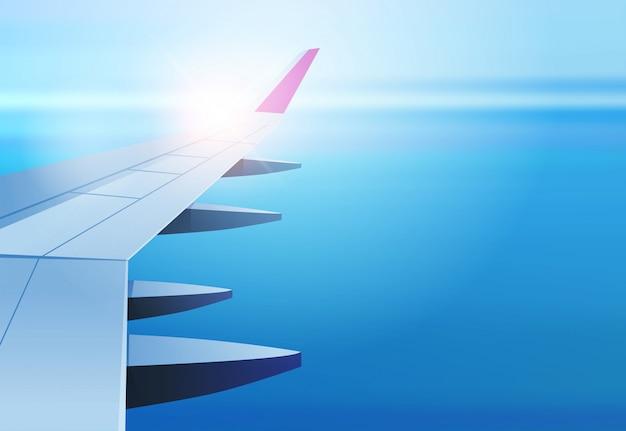 Vista de la ventana del avión en el espacio abierto del cielo con el concepto de transporte aéreo de turismo de viajes ala