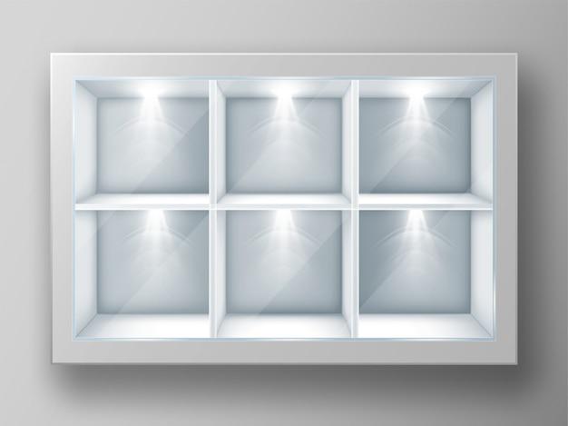 Vitrina blanca con estantes cuadrados y vidrio.