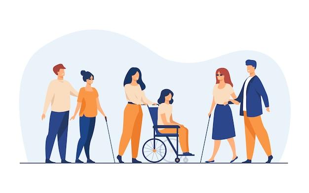Voluntarios ayudando a amigos discapacitados a caminar al aire libre