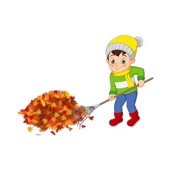 Voluntarios de chico lindo limpiando hojas de otoño