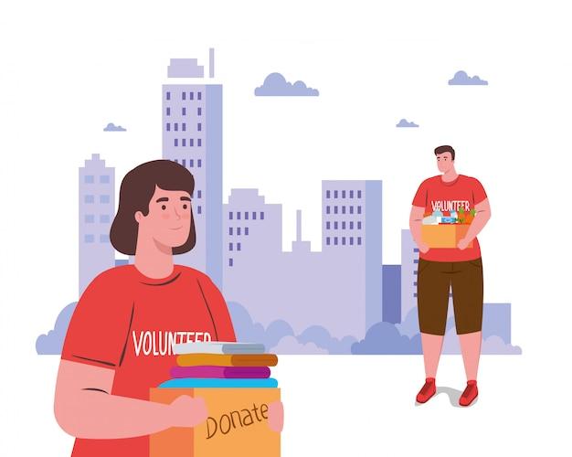 Voluntarios mujer y hombre con cajas de donación