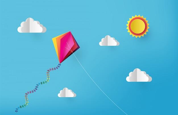 Vuelo colorido de la cometa en el cielo. estilo de corte de papel.