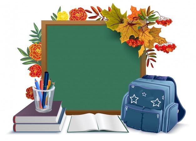 De vuelta a la escuela. pizarra, mochila, libros sobre hojas de otoño de fondo