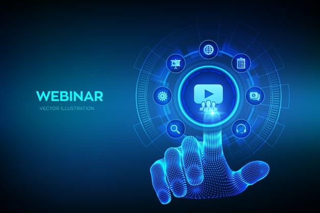 Webinar. conferencia por internet. la educación a distancia. concepto de e-learning en pantalla virtual. mano de estructura metálica tocando la interfaz digital.