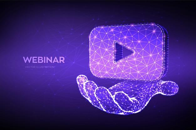 Webinar. icono de video o seminario web poligonal bajo abstracto en la mano. conferencia por internet. seminario basado en web.