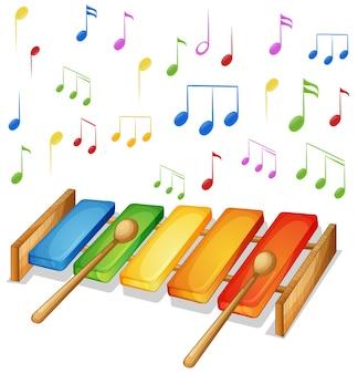 Xilófono con fondo de notas de música