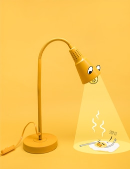Yellow lamp character illuminating a fried egg