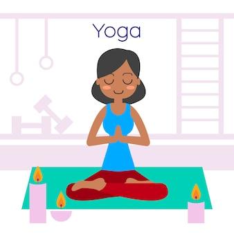 Yoga practicante de la mujer joven en actitud del loto.