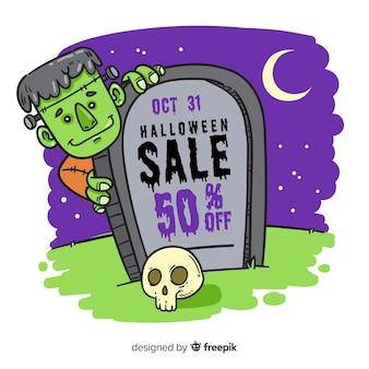 Zombie detrás de una venta de lápidas de halloween