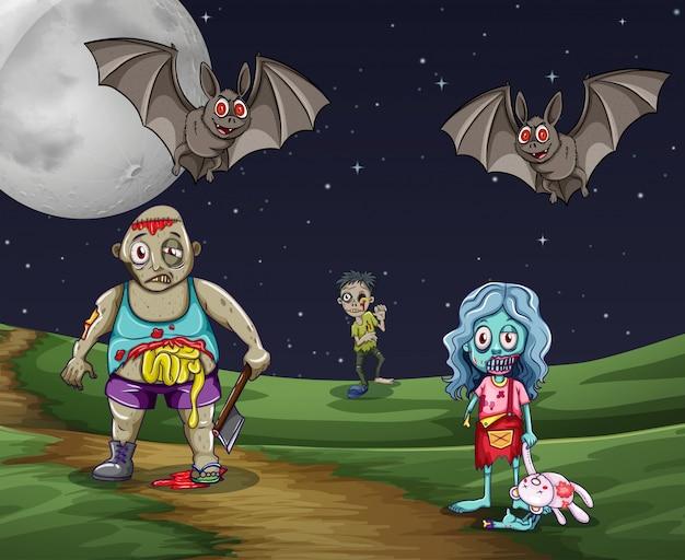 Zombies caminando en el suelo por la noche