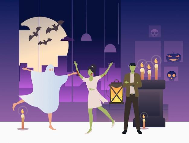 Zombis y fantasmas bailando en cuarto oscuro