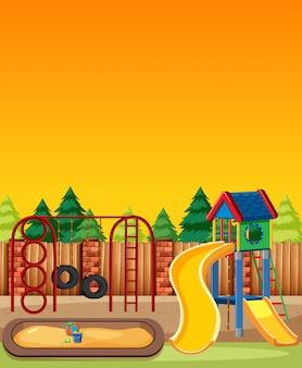 Zona de juegos para niños en el parque con estilo de dibujos animados de cielo de luz roja y amarilla