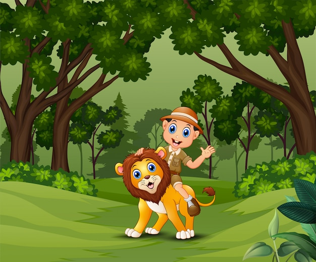 Zookeeper hombre con un león caminando por la selva