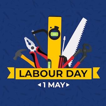 1. mai glücklicher arbeitstaghintergrund mit arbeitswerkzeugen