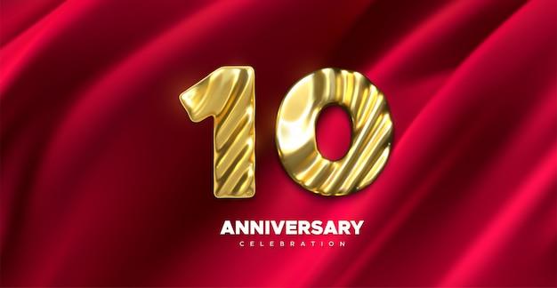 10 jubiläumsfeier. goldene nummer 10 auf rot drapiertem textilhintergrund. festliche illustration. realistisches 3d-zeichen.