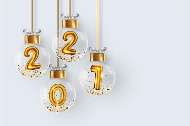 2021 hintergrund mit realistischen weihnachtskugeln
