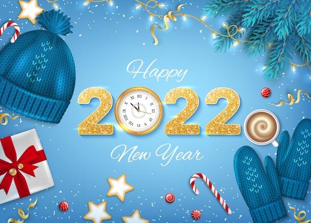 2022 frohes neues jahr goldene zahlen mit pailletten und wanduhr hintergrundkarte