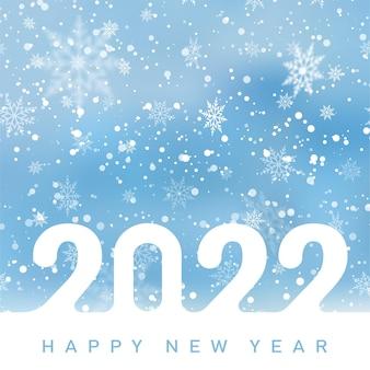 2022 happy new year-karte mit fallenden schneeflocken am blauen himmel. vektor