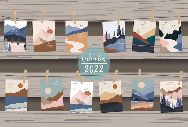 2022-tabellenkalenderwoche beginnt am sonntag mit berg, landschaft, die für vertikales digitales und bedruckbares a4 a5-format verwendet wird