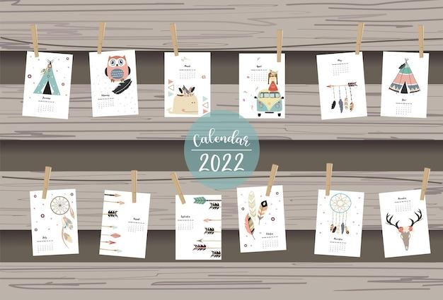 2022-tabellenkalenderwochenbeginn am sonntag mit boho-feder, die für vertikales digitales und bedruckbares a4 a5-format verwendet werden