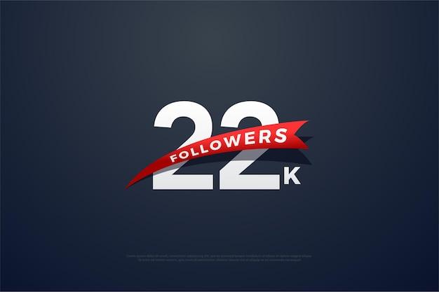 22k anhänger mit sich verjüngender roter schleife