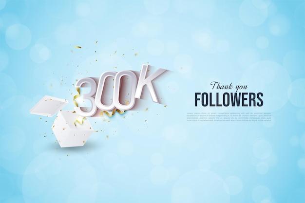 300.000 follower mit einer abbildung von zahlen, die aus der schockbox platzen.