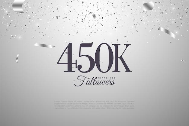 450.000 follower mit zahlen auf silbernem hintergrund