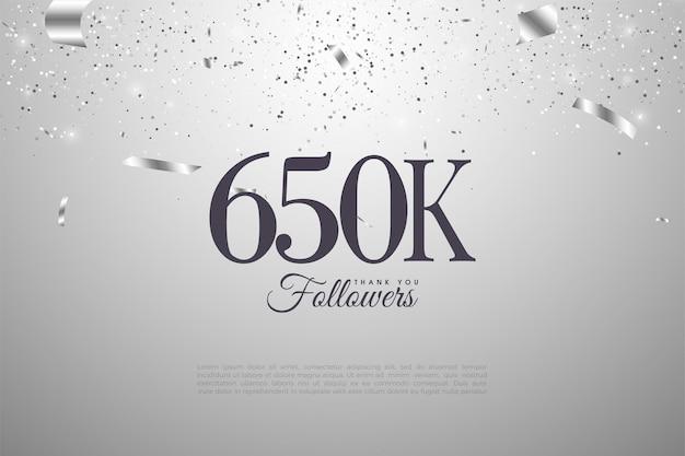 650.000 follower mit zahlen auf silbernem hintergrund