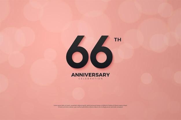 66-jähriges jubiläum mit schwarzen zahlen auf rosa hintergrund
