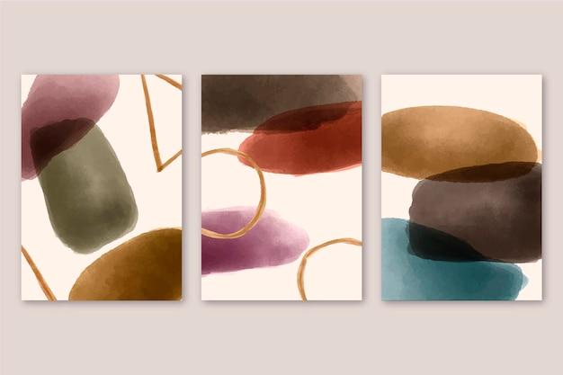 Abstrakte abdeckungen mit aquarellformen gesetzt