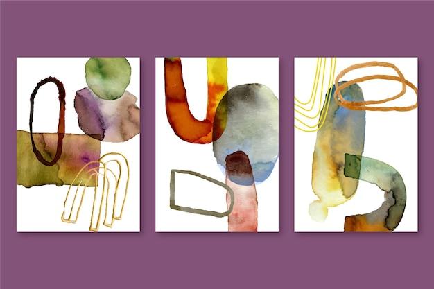 Abstrakte aquarellabdeckungen, die mit verschiedenen formen gesetzt werden
