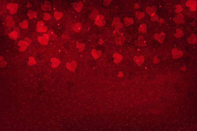 Abstrakte glühende weiche rote herzen für valentinstag-hintergrund