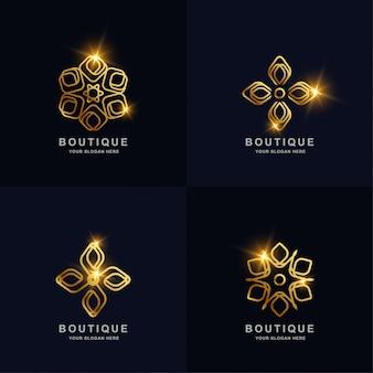 Abstrakte goldene blume oder boutique-verzierungslogo-satzsammlung.