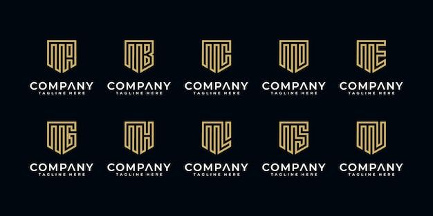 Abstrakte monogramm-logo-buchstabe m und usw. geschäft goldene logo-sammlung