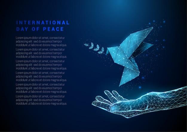Abstrakte offene hand mit fliegendem papiervogel mit olivenzweig