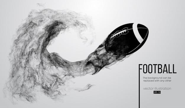 Abstrakte schattenbild eines amerikanischen fußballballs auf weißem hintergrund von partikeln, staub, rauch, dampf. fußball fliegt. rugby.