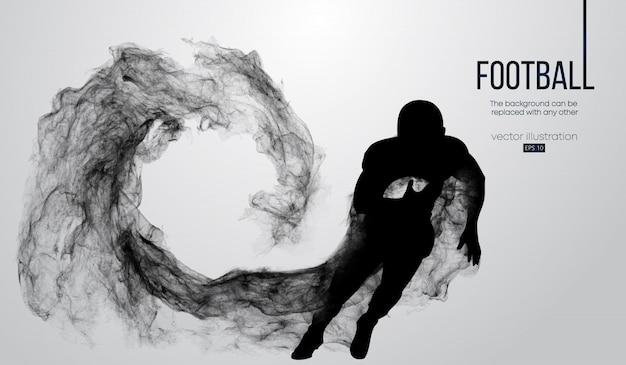 Abstrakte schattenbild eines amerikanischen fußballspielers auf weißem hintergrund von partikeln, staub, rauch, dampf. fußballspieler läuft mit ball. rugby.
