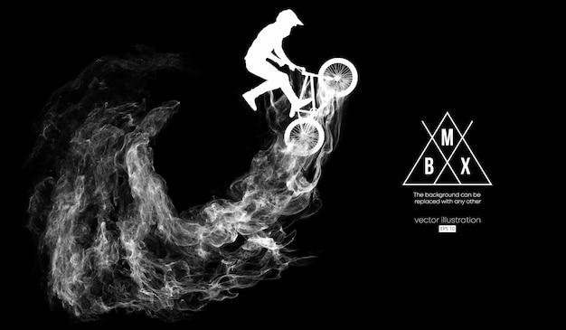 Abstrakte schattenbild eines bmx-fahrers auf schwarzem hintergrund