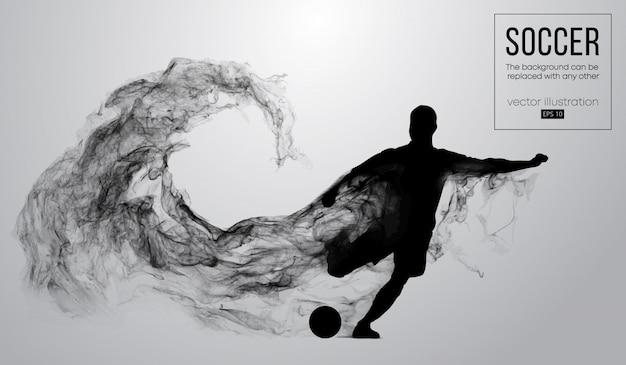 Abstrakte schattenbild eines fußballspielers auf dunklem schwarzem hintergrund von partikeln. fußballspieler läuft springend mit ball. welt- und europäische liga.
