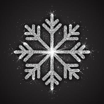 Abstrakte silberne funkelnde schneeflocke mit schimmernder glitzer-textur, isoliert auf dunkelgrauem hintergrund