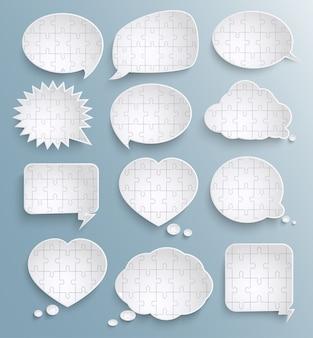 Abstrakte sprechblasen mit papierpuzzleteilen