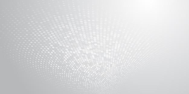 Abstrakter hintergrund aus halbtonpunkten in weißen und grauen farben