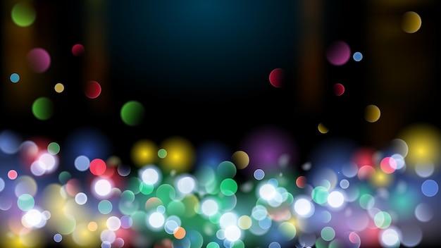Abstrakter hintergrund mit bokeh-effekt. unscharfe defokussierte mehrfarbige lichter. farbige bokeh-lichter auf schwarzem hintergrund.