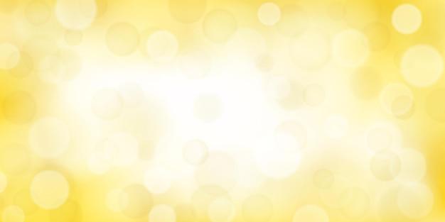 Abstrakter hintergrund mit bokeh-effekten in gelben farben