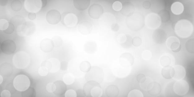 Abstrakter hintergrund mit bokeh-effekten in weißen und grauen farben