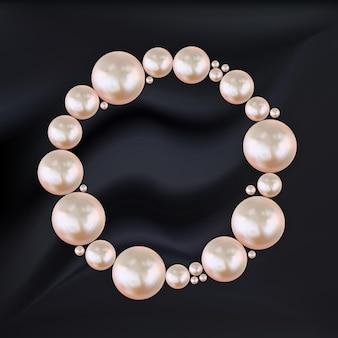 Abstrakter kreisrahmen der rosa perlen auf schwarzer seide