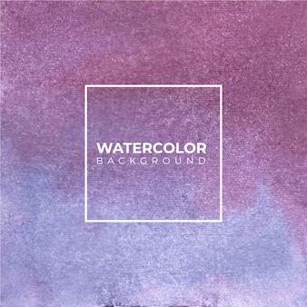Abstrakter lila blauer aquarellhintergrund. die farbe spritzt auf das papier.