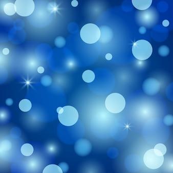 Abstrakter magischer verschwommener bokehhintergrund. blaulicht-feiertagsillustrationsbeschaffenheit. weihnachts- und neujahrsfeiertagsschablone